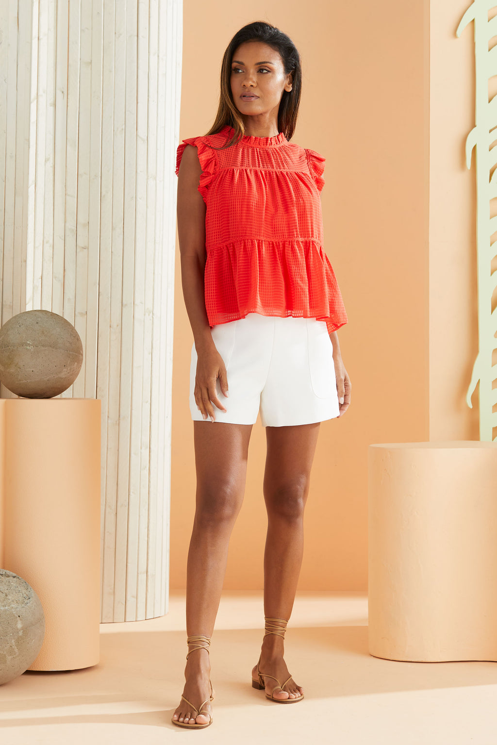 textured red top with ruffle detailing