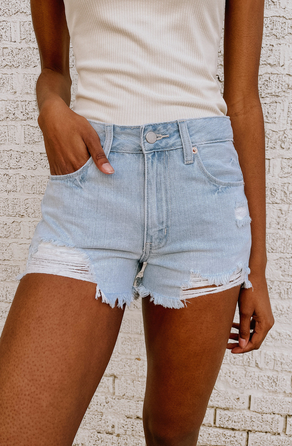 THROUGH THE FRAY HIGH RISE DENIM SHORTS