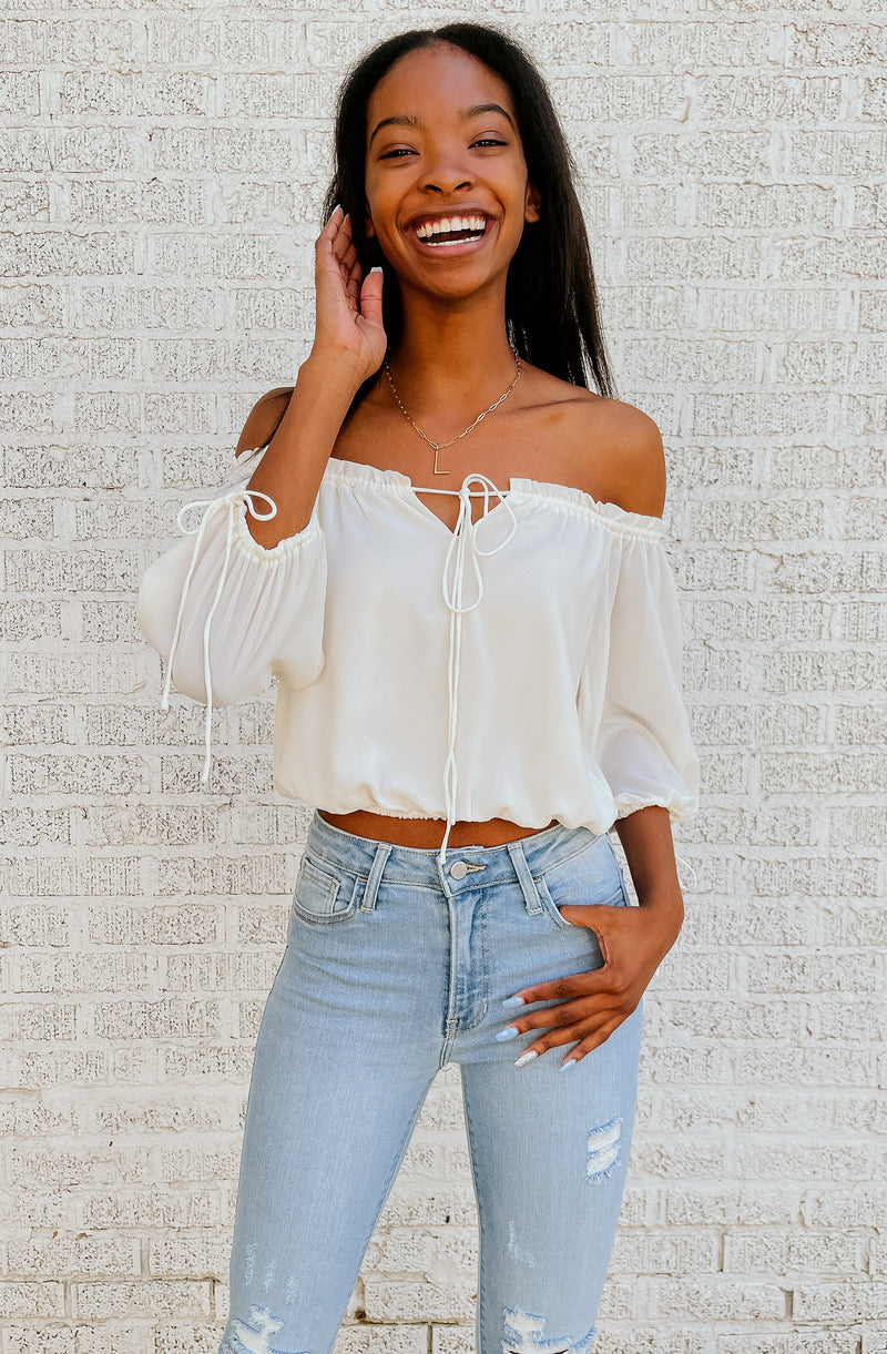 ITS ALL WHITE OFF THE SHOULDER TOP