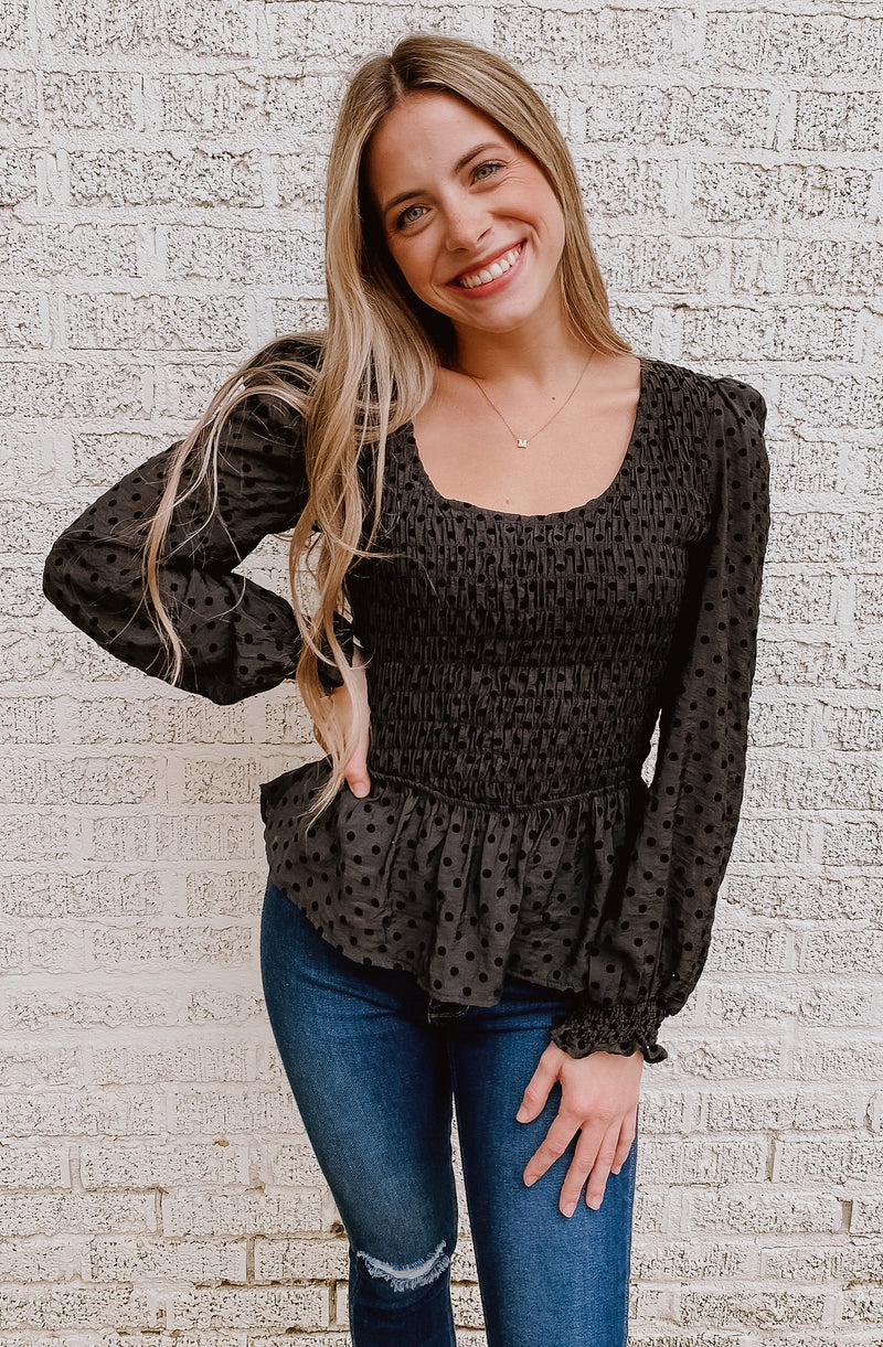 SMOCK DOWN TO THE DOT PEPLUM BLOUSE