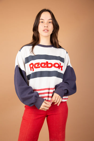 model wearing Reebok sweater, magichollow