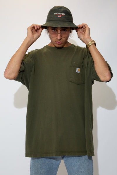 the model is wearing a olive green carharrt top that has slight distressing on the collar, the tee has a slight fade