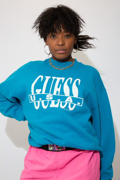 bottleg guess sweater in a blue colour-way. 90s vintage. magichollow.
