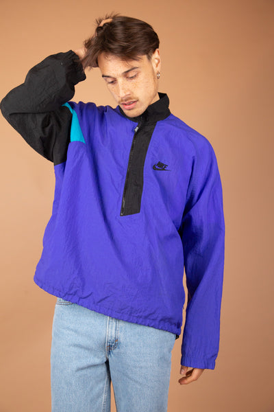 Royal blue nike windbreaker qarter-zip with one black sleeve with a small light blue detail. magichollow