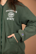 Load image into Gallery viewer, Model wearing Michigan State hooded sweater, magichollow