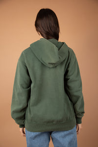 Model wearing Michigan State hooded sweater, magichollow
