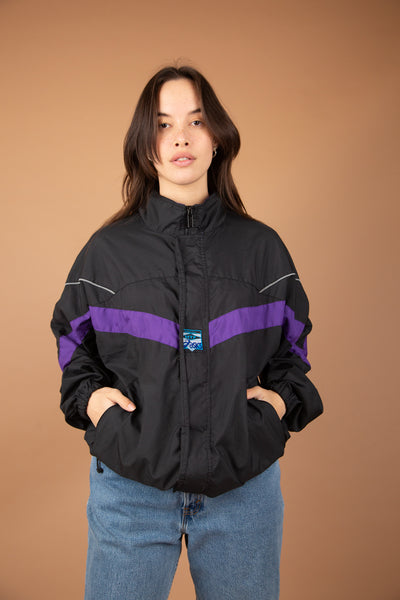 model wearing black and purple jacket