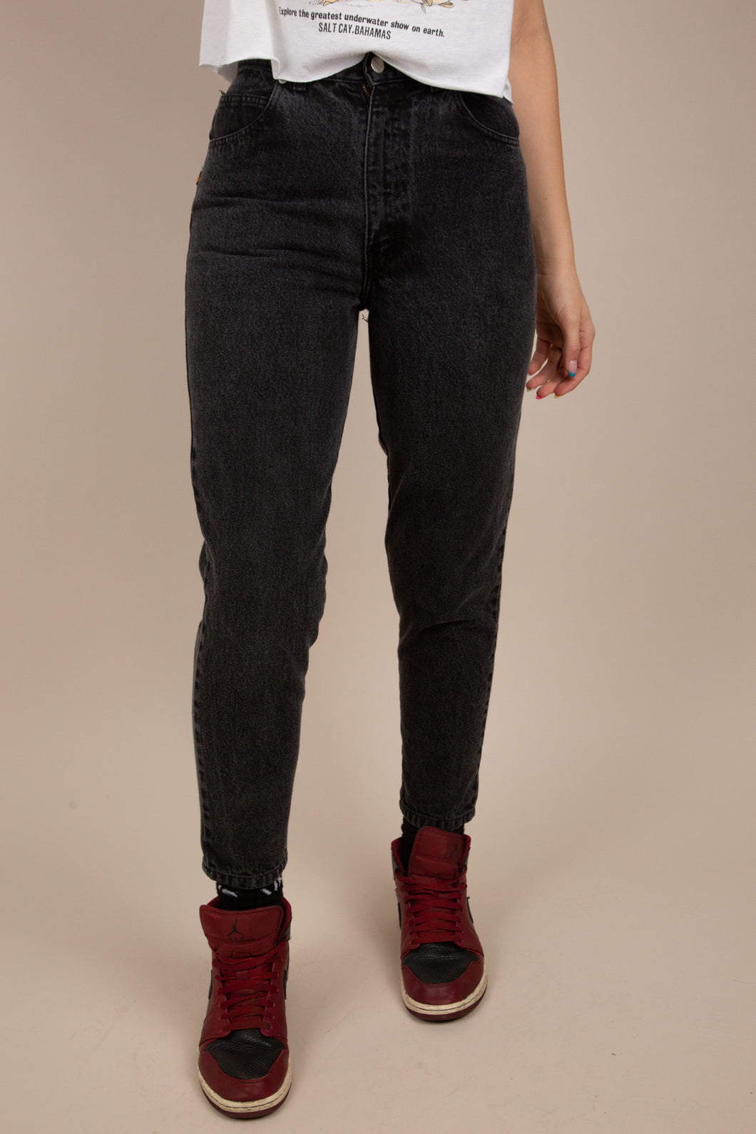 These tapered leg jeans are black with black stitching and silver buttons and domes.  Finished off with little bows on the back of the ankles and branded on the back pocket.