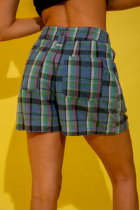 hese shorts have a pleated design with a high-waisted fit. Striped in blues, green and pinks and finished off with belt loops, pink buttons and plenty of pockets