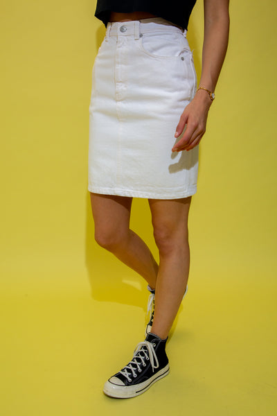White in colour, this skirt has a high-waisted fit in a midi-length design. With branding on the back pocket, domes and button.