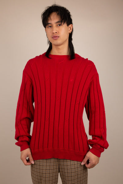 red ribbed knit with embroidered nautica logo on left chest