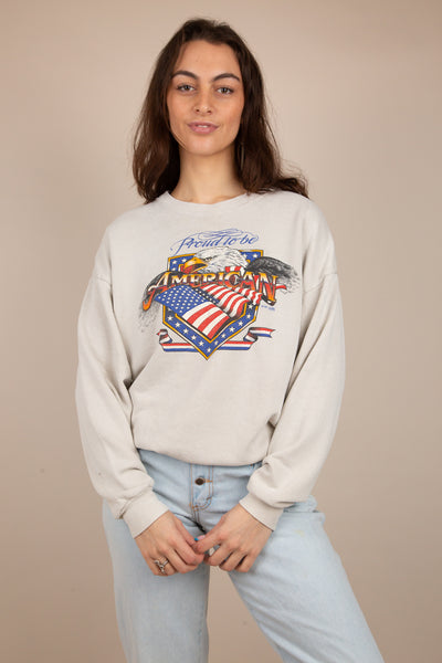 This 'Proud to be American' Lee sweater has a print of the US flag, an eagle and 'Proud to be American' printed across the front. Dated 1991, this sweater is a vintage must-have.