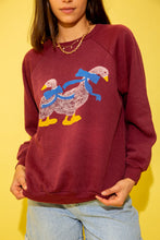 Load image into Gallery viewer, Maroon in colour with a stretched-out crew neck style and a colour print of two ducks on the front.