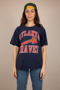 Navy blue single-stitch tee with red and white 'Atlanta Braves' across the front with logo below. Dated 1989. Stretched out neckline adds to loose fit.