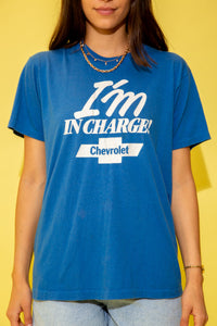 Blue in colour with a large white print of 'I'm in charge' on the front, repping Chevrolet below with the Chevy logo.