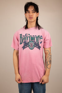 faded pink single-stitch tee with large Baltimore spell-out across chest