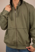 Load image into Gallery viewer, khaki zip-up hoodie with embroidered tommy flag detailing on left chest