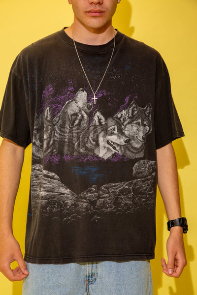 The model is wearing a black faded wolf tee featuring four wolves on the front and back