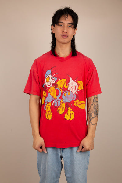 Red tee with Disney characters looking like they are bursting through. vintage clothing at magichollow