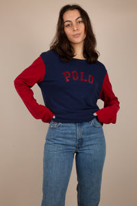 This Ralph Lauren Polo long-sleeved tee is navy blue with cherry red sleeves and cherry red POLO branding on the front. Stretched out neckline adds to the loose-fit.