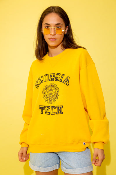 Yellow in colour with 'Georgia Tech' outlined in black big letters with the university's emblem below. Oversized, baggy fit.