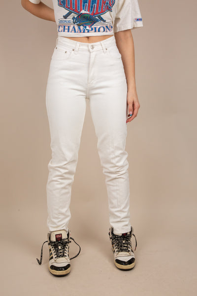 Model is wearing a pair of white high waisted, straight legged jeans. These jeans are made by Jordache