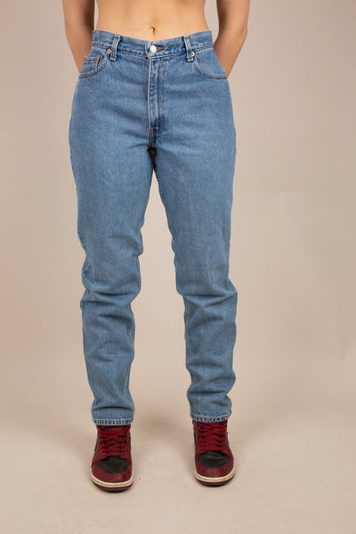 Model is wearing  a soft mid-wash denim in a baggy-to-tapered fit.