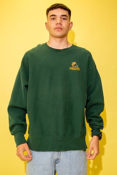 The model is wearing a greenbay packers sweater that features the iconic helmet on the left side.