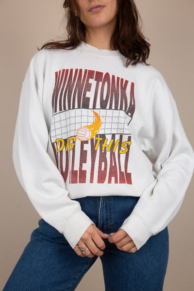 white sweater with winnetonka volleyball spell-out graphic