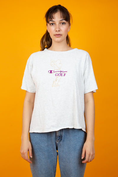 Light grey tee in a boxy fit. Tan and Purple embroidery on the front. Magichollow