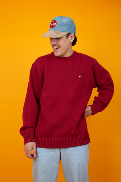 thick red cotton knit. small embroidered tommy hilfiger logo on the left side of the chest.