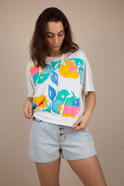 white cropped single stitch tee with colourful floral pattern