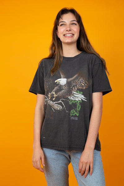Faded black tee with eagle graphic on the front. magichollow