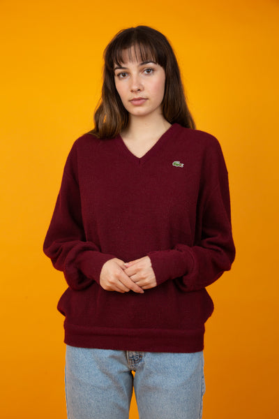 Model wearing maroon knit, magichollow