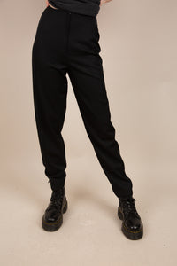 Model wearing black pants, magichollow