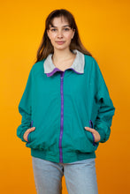 Load image into Gallery viewer, Female model wearing vintage green jacket