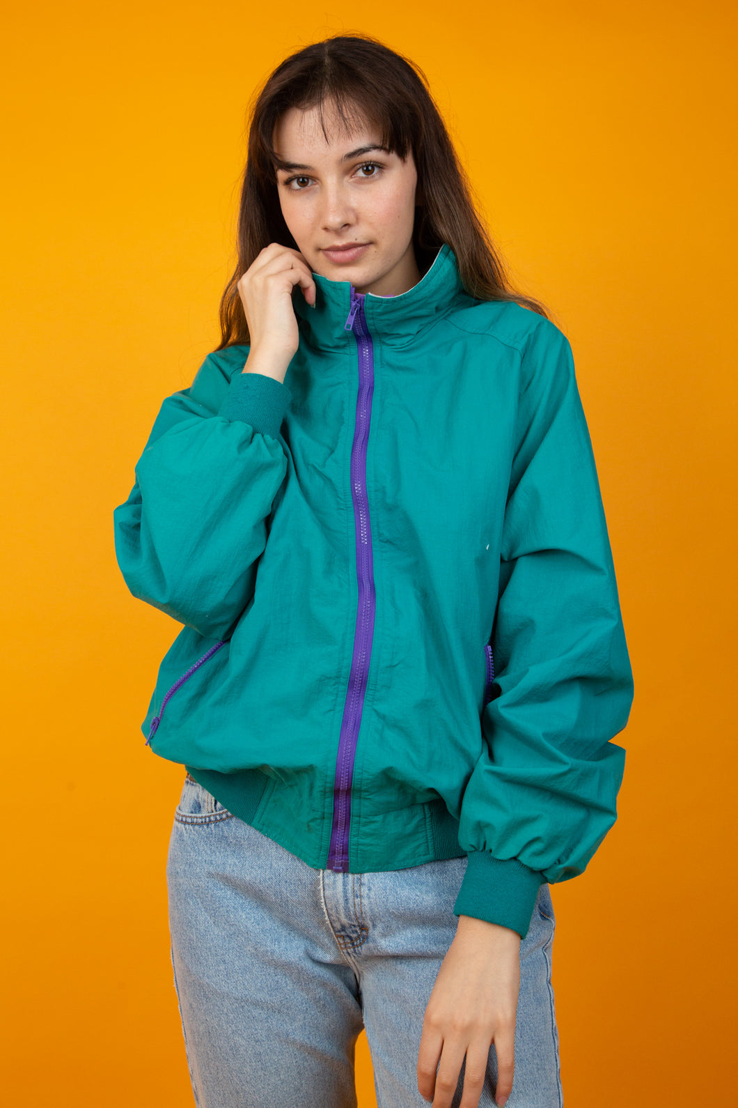 Female model wearing vintage green jacket
