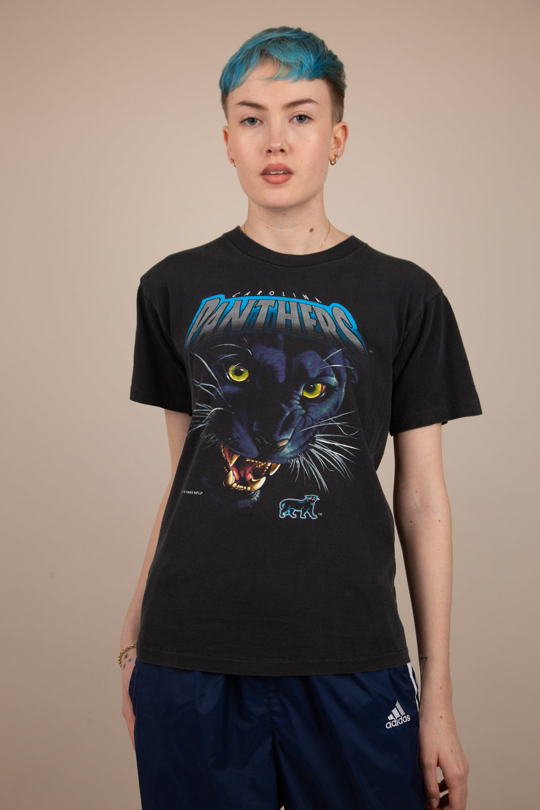 Model wearing Panthers tee, magichollow