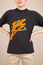 Load image into Gallery viewer, faded black top with 3/4 sleeves and vibrant bugle boy graphic