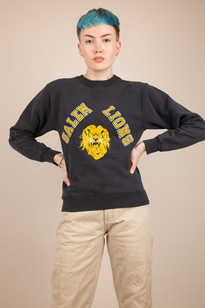 faded black fitted jumper with Salem Lions spell-out and logo graphic
