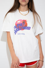 Load image into Gallery viewer, Model wearing Planet Hollywood tee, magichollow