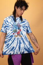 Load image into Gallery viewer, Walt Disney World Tee with a lit blue and white tie-dye style and a large print of Mickey in his fantasia get-up on the front. 'Four Parks One World Walt Disney World'  printed below.