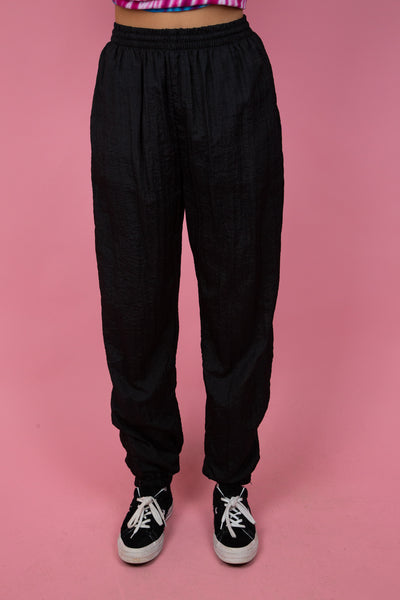 Female model wearing vintage black baggy track-pants