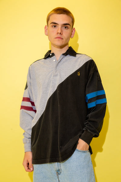 Sweater with a grey and black diagonal design, maroon and blue double striped arms, black collar, white buttons and a yellow Nautica logo on the left chest.