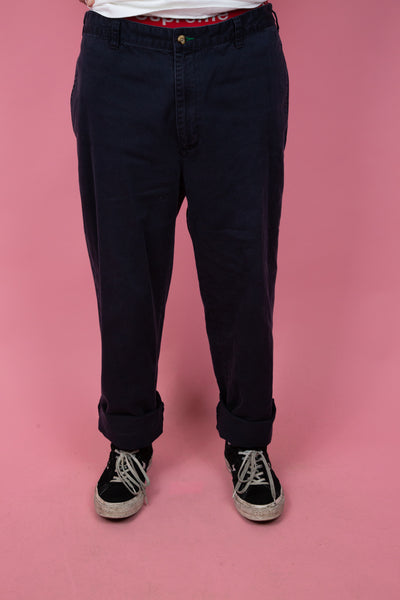 vintage Tommy Hilfiger chinos in a navy blue colour-way. shop now. 90s vintage. magichollow.