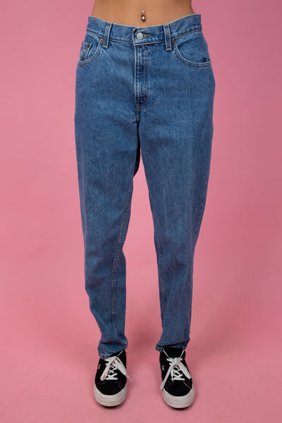 Mid-wash blue denim jeans in a baggy to tapered fit. 90's vintage. magichollow