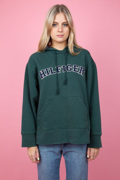 green tommy hilfiger hoodie with a large HILFIGER graphic and front pocket. magichollow