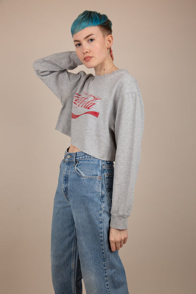 model wearing coca-cola cropped sweater, available from magichollow