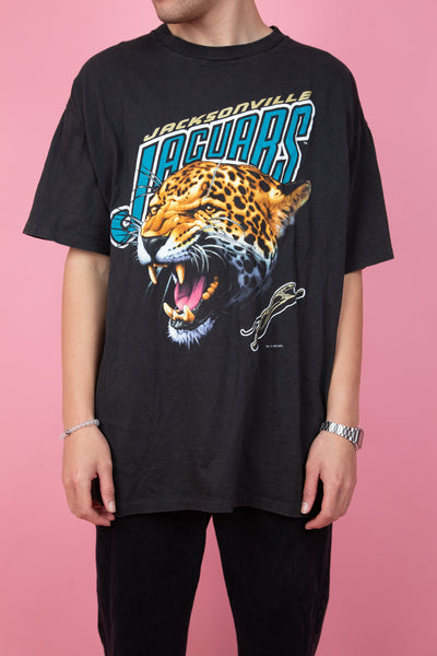 90s vintage black tee with jacksonville jaguars spell-out and graphic