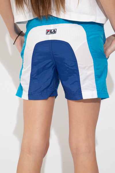 model wearing Fila shorts, magichollow